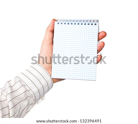 Hand with a notebook