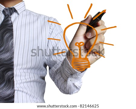 hand with a pen drawing light bulb - stock photo