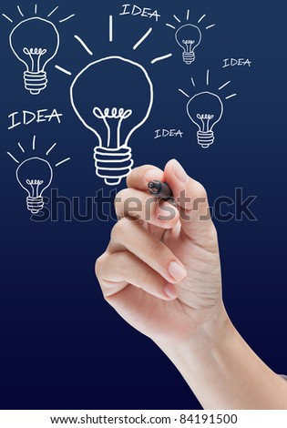 hand with a pen drawing light bulb idea style - stock photo