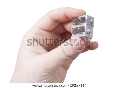 hand with a pencil sharpener isolated over a withe background