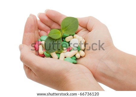 Hand with a pill on white background - stock photo