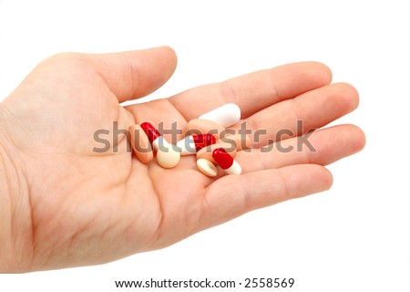 hand with a pills (medical concept)