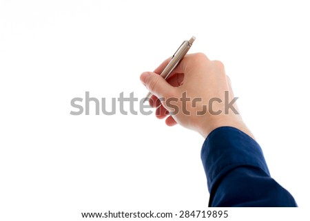 hand with a polished pen is writing in white space