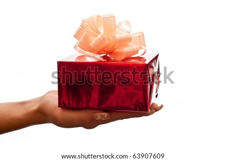 Hand with a red gift box with gold bow isolated on white background - stock photo