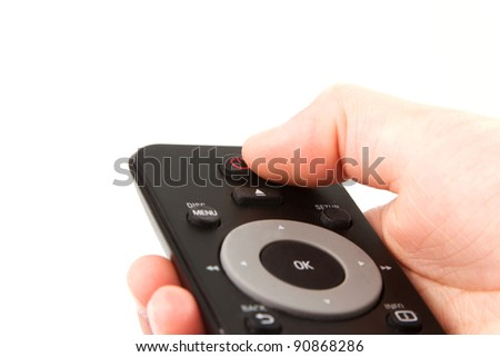 Hand with a remote in front of a white background - stock photo