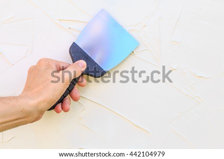 Hand with a spatula - stock photo