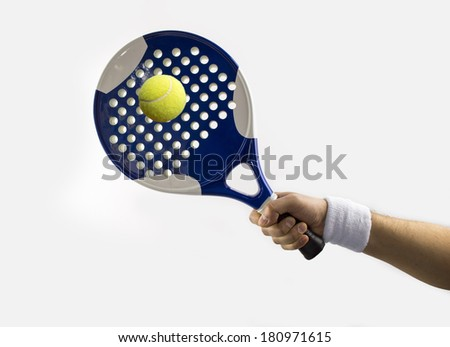 hand with a tennis racket hitting a ball paddle - stock photo