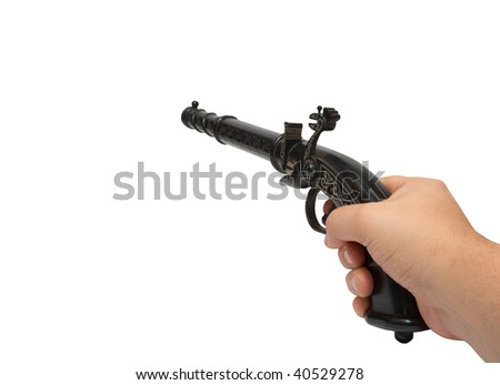 Hand with aimed old gun.  Isolated on white, with clipping path. - stock photo