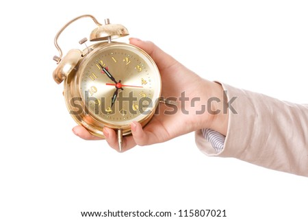 Hand with alarm clock isolated on white background - stock photo