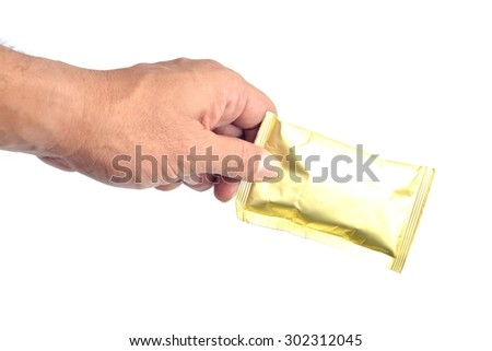 Hand with an aluminum bags on white background.  - stock photo