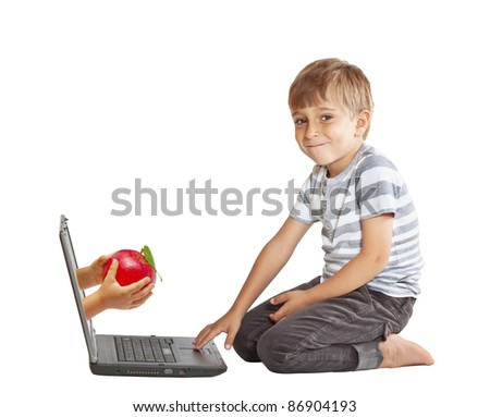 hand with an apple and through the computer screen - stock photo