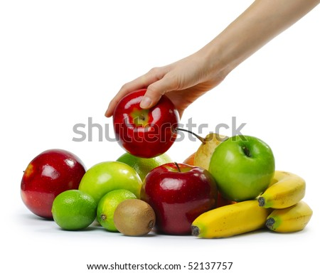 Hand with apple over heap of fruits - stock photo