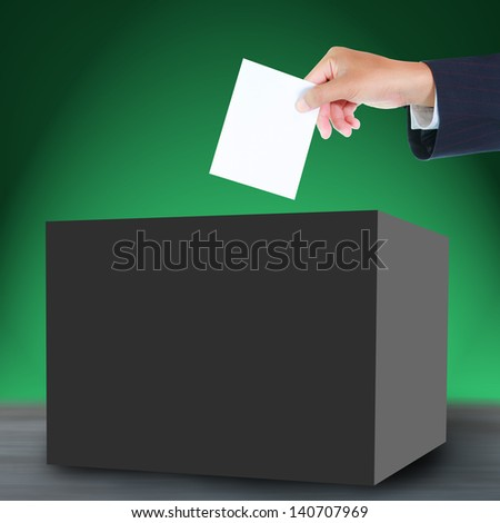 Hand with ballot and box - stock photo