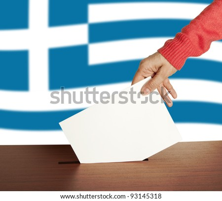 Hand with ballot and box on Flag of Greece
