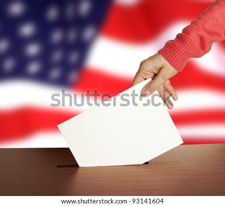 Hand with ballot and box on Flag of USA - stock photo