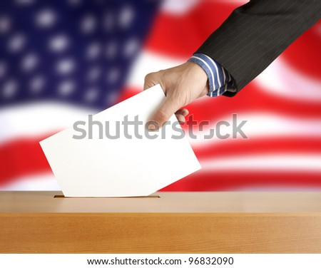 Hand with ballot and box on Flag of USA - stock photo