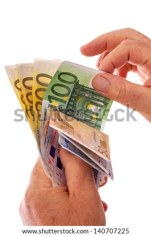 Hand with banknotes - stock photo
