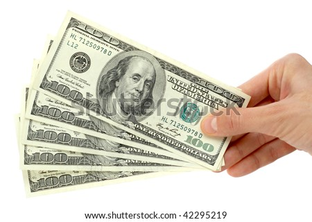 Hand with $100 banknotes stack isolated on white