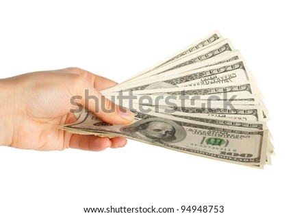 Hand with $100 banknotes stack isolated on white background