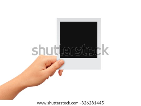 Hand with blank photo card, add your image - stock photo
