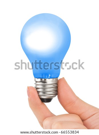 Hand with blue lamp isolated on white background - stock photo
