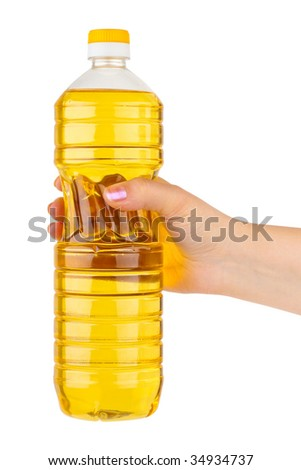 Hand with bottle of cooking oil isolated on white background - stock photo