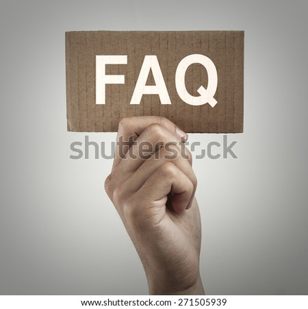 Hand with brown card is showing faq with gray gradually varied background.