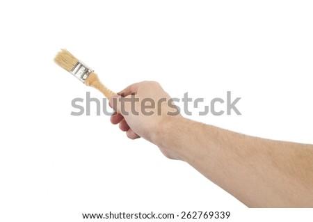 Hand with brush - stock photo
