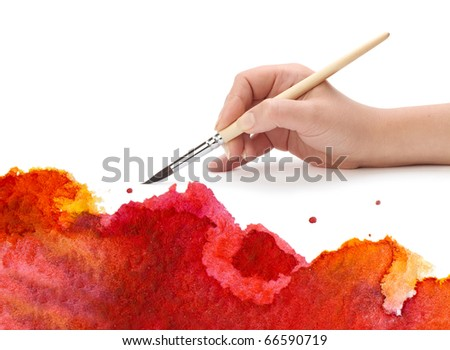 hand with brush and paint - stock photo