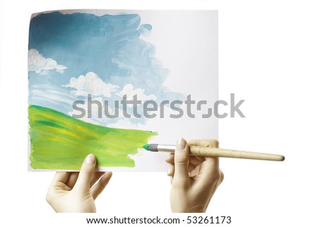 Hand with brush and paper with drawing - stock photo