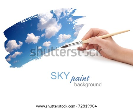 hand with brush and sky paint - stock photo