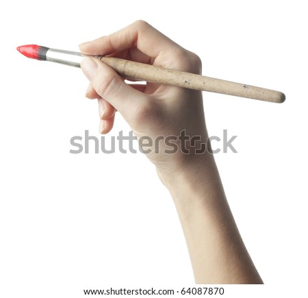Hand with brush on white background - stock photo