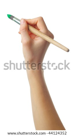 Hand with brush stained in red paint - stock photo
