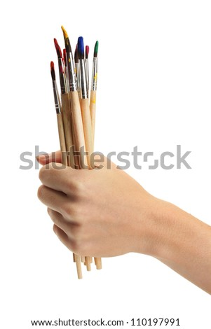 hand with brushes isolated on white - stock photo