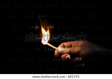 "Hand with burning flame, lighting words in darkness ""Idea Create Lead Inspire Explore Spark"" - represents leadership and ingenuity in business, school, and personal life. - stock photo"