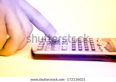 Hand with calculator - stock photo