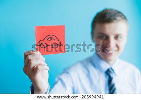 Hand with car - stock photo