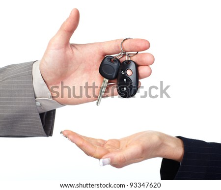 Hand with Car key. Isolated over white background. - stock photo