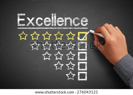 Hand with chalk is drawing Excellence concept on the chalkboard. - stock photo