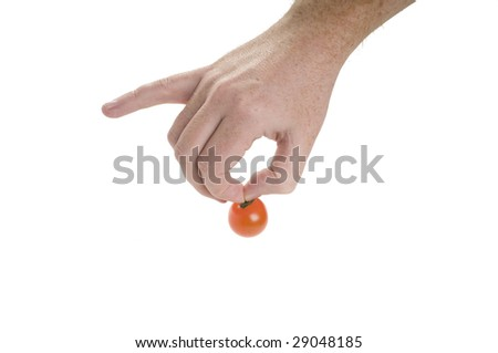 Hand with cherry tomato isolated on white background