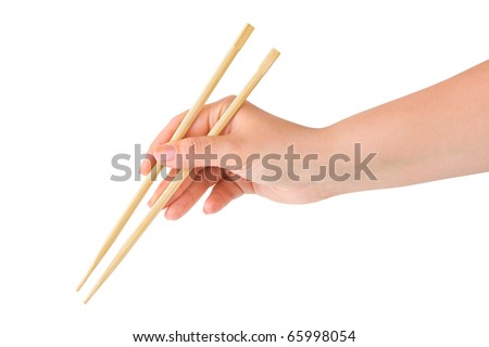 Hand with chopsticks isolated on white background - stock photo