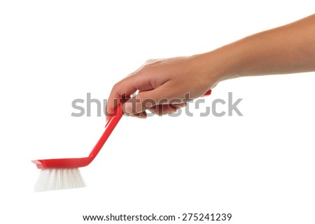 Hand with cleaning brush - stock photo
