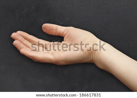 Hand with Clipping Path on Blackboard Background - stock photo