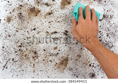 Hand with cloth is going to wipe the dirty surfaces - stock photo