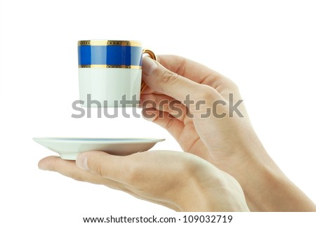 Hand with coffee cup on white background