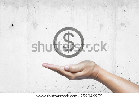 Hand with coin icon on wall.