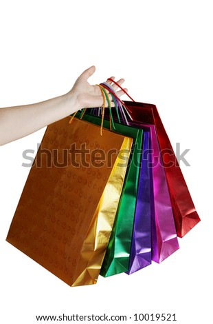Hand with color bags, isolated on white background - stock photo