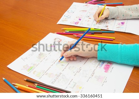Hand with Colored Pencil Drawing Homework. School Concept. - stock photo