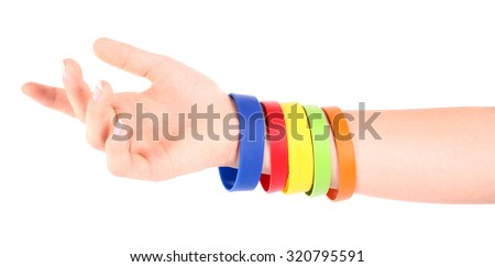 Hand with colorful rubber bracelets