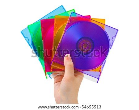Hand with computer disks isolated on white background - stock photo